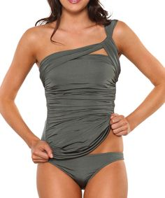 A golden tan looks extra glam when offset by a fabulous swimsuit.Hidden tummy control panels team up with a contemporary asymmetrical shoulder and ruched detailing to streamline curves, while the classic brief bottoms provide a flattering, full-coverage fit.Includes top and bottoms91% nylon / 9% spandexHand wash; dry flatMade in the USA