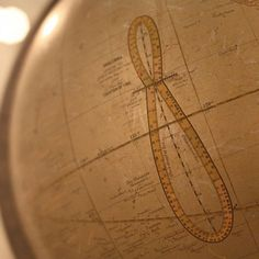 This curved line is called an analemma.  It shows sun's declination - its annular distance from the celestial equator - and difference (in minutes) between time as measured by the clock and time as measured by the sun.  Click here to read more about this image.