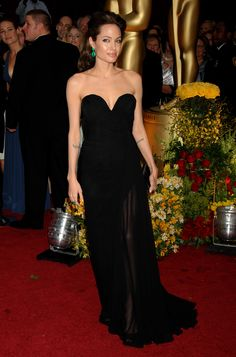 Angelina Jolie in Elie Saab gown, Lorraine Schwartz jewelry, Ferragamo shoes and Lana Marks bag at the 2009 Oscars – her first with partner Brad Pitt.