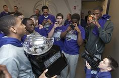 Making memories! The K-State men's basketball players capture the Big 12 Championship trophy with their mobile devices. Copyright K-State Photo Services.