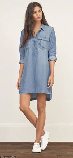 New: The retailer says it is returning to its roots of simple, classic design. Above, a model wears a denim shirtdress on the company's updated website