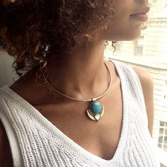 This bold collar necklace lives up to this motto: striking with the turquoise pendant, remove it + the gold collar can be worn to the front or back!