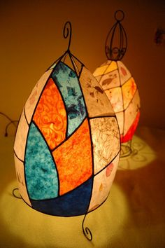 Wire and paper lamps. Somehow they remind me of Miro.
