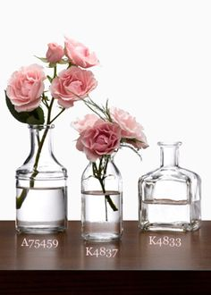 CLEAR GLASS BOTTLE BUD VASES: CREATE EASY AND PRETTY GROUPINGS OF SINGLE FLOWER STEMS, OR SMALL BOUQUETS, AS DECORATIVE ACCENTS OR TABLE CENTERPIECES, IN THESE CLEAR GLASS BOTTLE BUD VASES.   6 for $12