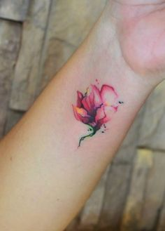 Love this! Floral wrist tattoo, watercolours