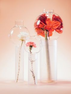 An incredibly different way to display cut flowers in clear glass bulb vase! Olfattorio Vases by Cristina Celestino