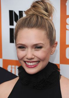 Elizabeth Olsen. Love the top knot on her! She is so much prettier than her sisters just because she smiles. It's a beautiful happy smile.