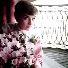 "Audrey Hepburn in her apartment window when she was travelling with the play of ""Gigi"", 1953. Photo: Bob Willoughby"