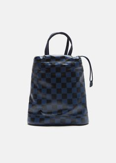 Navy and black checkerboard faux-leather pouch bag with dual drawstring closure. Cloud shape at base. Detachable, adjustable shoulder strap. Logo tags at drawst