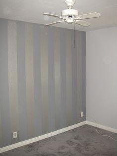 flex room: three walls (front door, opposite stairs and wall with inset) in a tonal vertical stripe.
