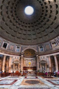 Walking around in the circle of the Pantheon, looking up, and the morning sun streaming down.
