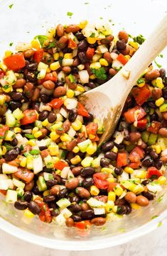 Mexican Bean Salad This Mexican Bean Salad Recipe is a quick and easy throw-together salad that 39 s full of great flavor Made with beans celery cilantro tomatoes onions peppers lime and slices this is a delicious side dish the whole family will love Mexican Food Recipes, Diet Recipes, Vegetarian Recipes, Cooking Recipes, Healthy Recipes, Cheap Recipes, Organic Recipes, Mexican Bean Salad, Corn And Bean Salad