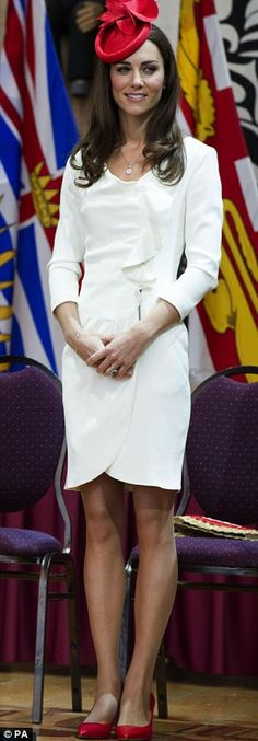 The Duchess of Cambridge To celebrate Canada day Kate wears the national colours opting for a cream Reiss dress,