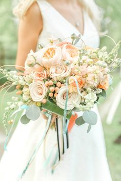 peach bouquet, photo by The Nolans http://ruffledblog.com/magnolia-hill-wedding #weddingbouquet #flowers