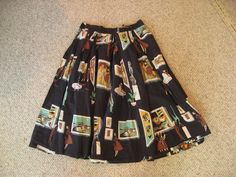 LOVE the print on this skirt!! 1950's border print skirt with art gallery theme - black colorway.