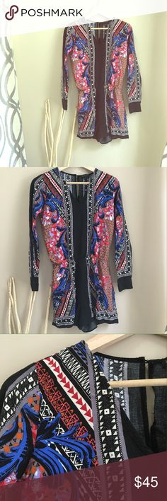 Gorgeous Summer Romper Beautiful design. Shorts go to mid thigh. Great condition. Only worn twice. Long sleeve. v-neck and part of back out. Dresses Long Sleeve