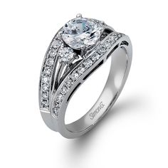 Trio Collection - This gorgeous 18K white engagement ring is comprised of .60ctw round white Diamonds.   - LP890
