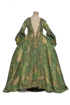 1740  Very beautiful fabric and construction.  Too bad the stomacher is missing!