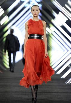 """""""HUGO BOSS BLACK - WOMENSWEAR - FALL WINTER 2013""""  The orange is such a great, warm colour for fall. I love this dress paired with the black accessories, because it gives it a more industrial vibe. My favorite thing about the dress is the way is flows, it's an understated elegance."""
