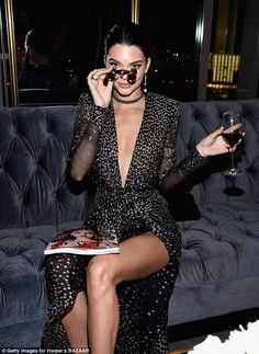 Sitting pretty: Kendall worked her poses like a pro inside the party