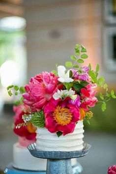 beautiful mini cake with pink florals - so cute for a bridal shower | galvanized tin pedestal available at http://www.simplysouthernwedding.com/wedding-dessert-table/cake-stands/