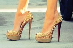 Gold spike heels.