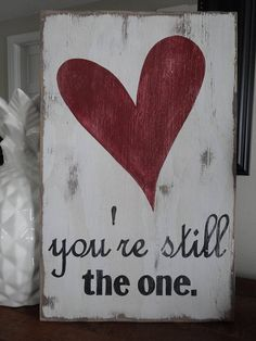 Youre still the one sign. This sign would be a special gift for the one you love on Valentines day or any day of the year. This rustic love sign is 10 inches wide by 15.5 inches tall. Stain is painted on the front and back, there is a white painted on top, the words are black and