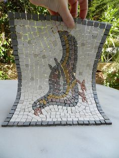 Making a mosaic on mesh is explained in easy to follow steps with clear illustrations in this tutorial by Helen Miles Mosaics.