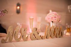 Image from http://www.knotsvilla.com/wp-content/uploads/2014/12/Gold-blush-wedding-mr-mrs-sign.jpg.