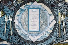 blue sequin tablecloth and blue marbled plate // tablescape