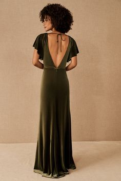 Flutter sleeves and a v-neckline top off this fitted, floor-skimming dress in luxurious velvet. An open back topped with a slender tie makes a dramatic finishing touch.