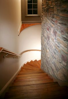 Stairs to the basement behind the great room fireplace    http://www.dongardner.com/images.aspx?pid=3217=interiors\5019stair.jpg