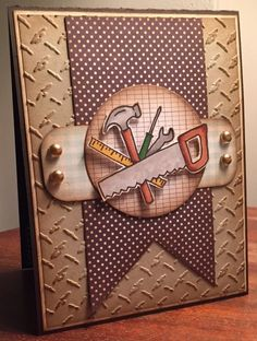 handmade masculine card by Kim ... kraft and browns ... carpenter's tools ... metallic brads ... great card ...