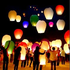 10 20 50 Multi Color Chinese Lanterns Sky Fly Candle Lamp for Wish Party Weddin | eBay -- My mom just ordered these for my wedding using a Groupon. This looks so cool, I can't wait to let them go on our wedding night :)