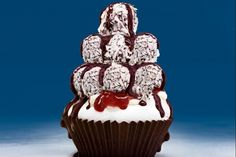 Here's the ultimate Aussie dessert - lamington truffles stacked on a pavlova cupcake.
