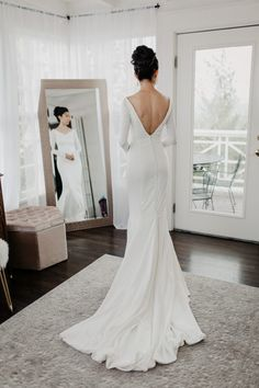 The exposed back on this modern and classic bridal dress has us in love | Image by Summer Leigha Photography #modernwedding #minimalistwedding #rusticwedding #mountainwedding #coloradowedding #wedding #weddinginspiration #weddingphotography #bride #bridalinspiration #bridalstyle #bridalfashion #weddinggown #weddingdress