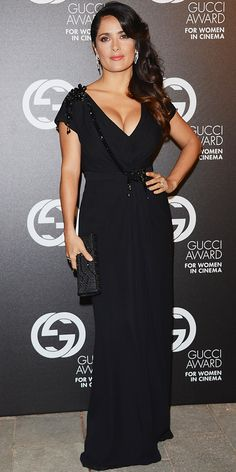 At the Venice Film Festival, Hayek Pinault feted the Gucci Award for Women in Cinema in a black ensemble, including a plunging column and embellished satin clutch.