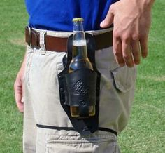 Black Leather Beer Holster Rugged leather holster keep the beer at your fingertips and the crowd at your mercy. hidden back pocket to keep your valuables safe. Made of black leather. Measures 10 x . Fathers Day Gifts, Gifts For Dad, Brother Gifts, Daddy Gifts, Guy, Bottle Carrier, Leather Holster, Mo S, Beer Lovers
