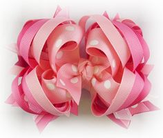 Girls all pink hair bow perfect for birthdays or other celebrations! Layers and layers of pink, hot pink, shocking pink, and light pink.