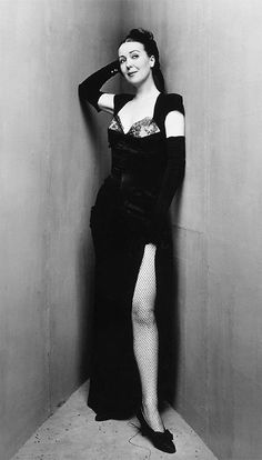 Gypsy Rose Lee    'Irving Penn(1917– 2009) was anAmericanphotographerknown for hisportraitureandfashion photography. He was among the first photographers to pose subjects against a simple grey or white backdrop. Expanding his austere studio surroundings, Penn constructed a set of upright angled backdrops, to form a stark, acute corner.'