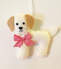 This Christmas ornament makes a great gift for anyone who loves Labrador Retrievers!  He is designed and handmade by me! He is about 4 inches tall and 5 inches long.  Find more cute ornaments here https://www.etsy.com/shop/BeckyLynnCreations?ref=hdr_shop_menu&section_id=16548535