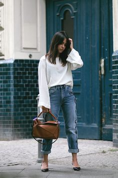 Nisi is wearing: Embroidered boyfriend jeans, shirt with big sleeves, Loewe Puzzle bag, Jimmy Choo Tide sling-back pumps - teetharejade.com