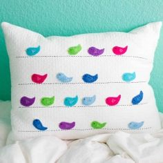 Make an easy, bright and fun embroidered felt bird pillow