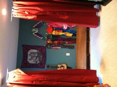 Playroom stage!  I used 2 shipping pallets and screwed plywood on top. The costumes are all hung with 3m hooks. The curtain wire is Dignitet from Ikea and the curtains are tablecloths.