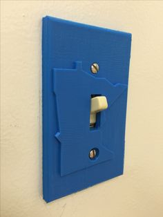 3d printed light switch plate. Designed using Autodesk Inventor. Printed on Makerbot Replicator.