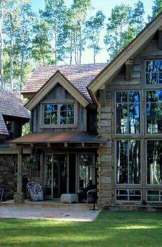 Like the little room off to side with different elevation for Log home windows