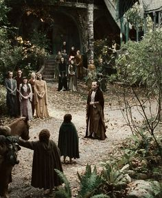Many others of Elrond's household stood in the shadows and watched them go, bidding them farewell with soft voices. There was no laughter, and no song or music. At last they turned away and faded silently into the dusk.