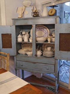 Love antique cabinets wish I could find a pie safe like my grandmother had