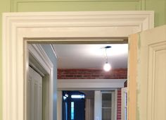 In order to widen the doorway and retain balance in design of the room, contractors modified the frame and pieced sections of wood into the existing door. The finished product displays a mark of true craftsmanship.