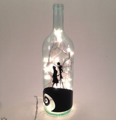 Recycled wine bottle made into a lamp with the Jack and Sally from Nightmare Before Christmas on the front. This light is the perfect accessory to